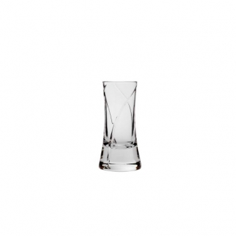 A crystal shot glass with fine lines cut into the surface