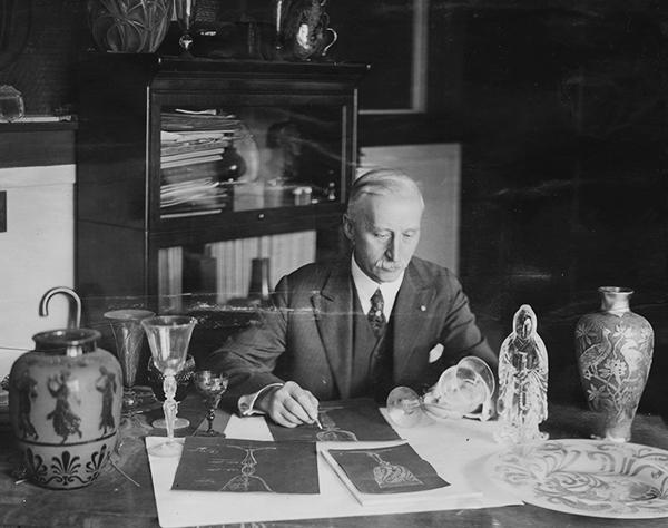 Frederick Carder at his desk